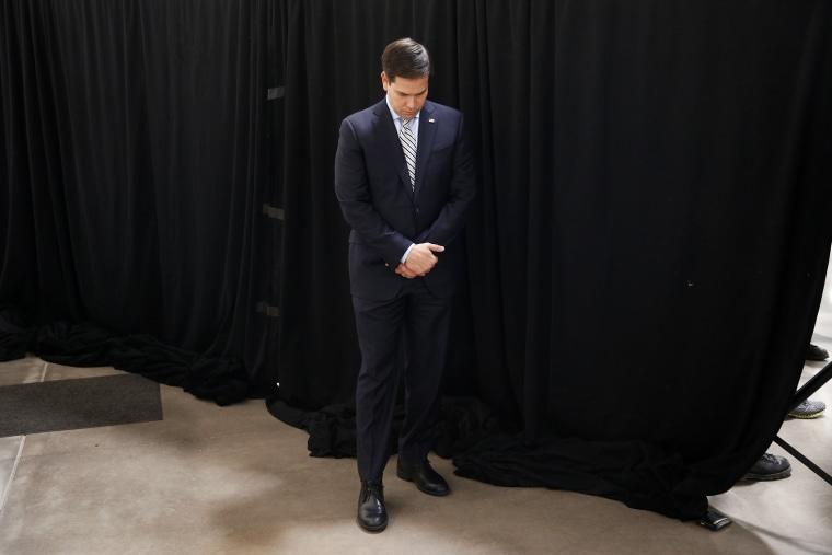 Republican presidential candidate, Sen. Marco Rubio, R-Fla., bows his head in prayer at a campaign rally in Idaho Falls, Idaho, March 6, 2016. (Photo by Paul Sancya/AP)