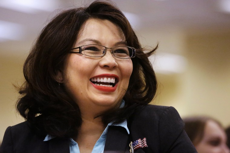 In this Aug. 13, 2014 file photo, Rep. Tammy Duckworth, D-Ill., acknowledges applause in Springfield, Ill. (Photo by Seth Perlman/AP)