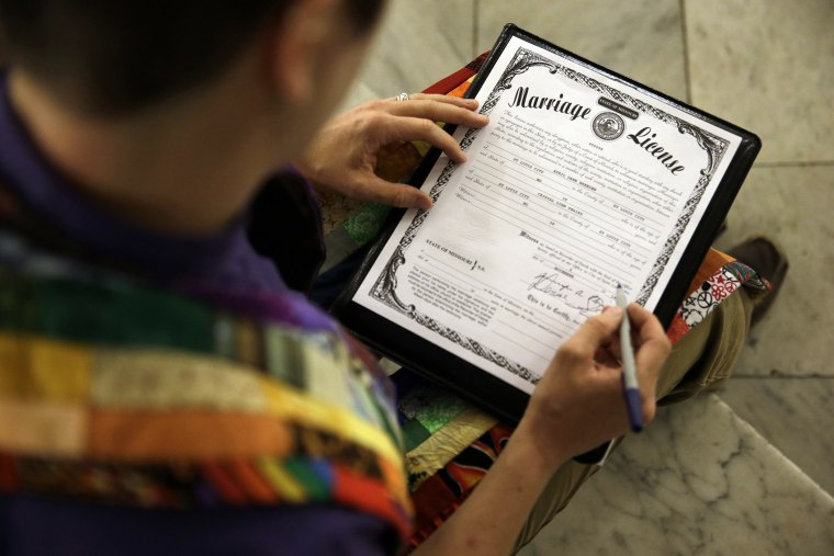 In this Nov. 5, 2014 file photo, a Missouri marriage license is signed after a same sex marriage ceremony in St. Louis, Mo. (Photo by Jeff Roberson/AP)