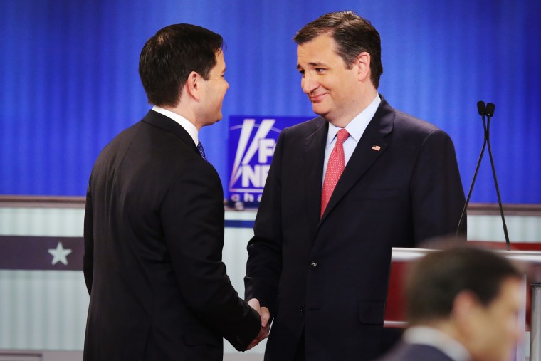Republican presidential candidates Sen. Marco Rubio (R-FL) and Sen. Ted Cruz (R-TX) shake hands in a debate at the Fox Theatre on March 3, 2016 in Detroit, Mich. (Photo by Chip Somodevilla/Getty)