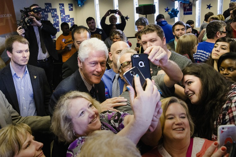 Former President Bill Clinton has pictures taken with attendees as he campaigns for his wife, Democratic presidential candidate, Hillary Clinton, March 9, 2016, Columbus, Ohio. (Photo by John Minchillo/AP)