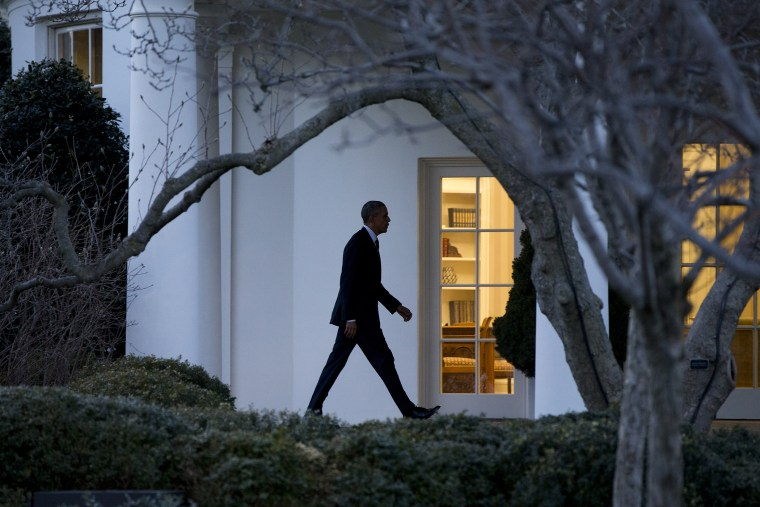 President Barack Obama walks to the Oval Office if the White House in Washington, D.C., Feb. 26, 2016. (Photo by Carolyn Kaster/AP)