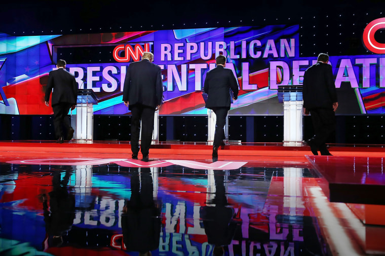 Republican presidential candidates walk to their podiums at the start of the Republican Presidential Primary Debate on the campus of the University of Miami on March 10, 2016 in Coral Gables, Fla. (Photo by Joe Raedle/Getty)