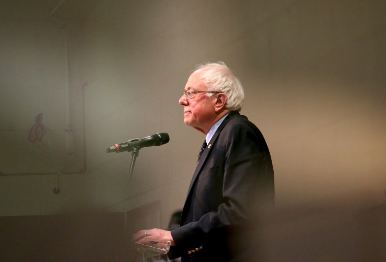 Vermont Senator and Democratic U.S. presidential candidate Bernie Sanders is seen through a window as he speaks at a town hall forum at the Olivet Institutional Baptist Church in Cleveland, Ohio, March 5, 2016. (Photo by Aaron Josefczyk/Reuters)
