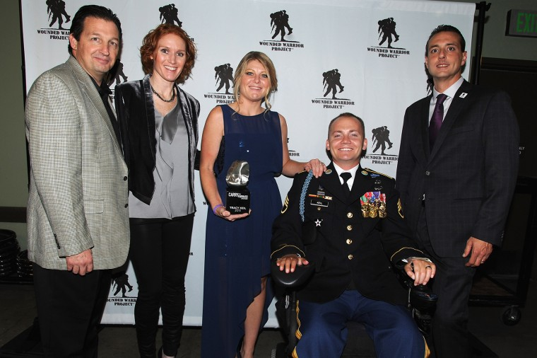 Al Giordano (far left), Steve Nardizzi (far right) and The Carry Forward Awardees attends the Wounded Warrior Project Carry Forward Awards Show at Club Nokia on Oct. 10, 2013 in Los Angeles, Calif. (Photo by Bobby Bank/WireImage/Getty)