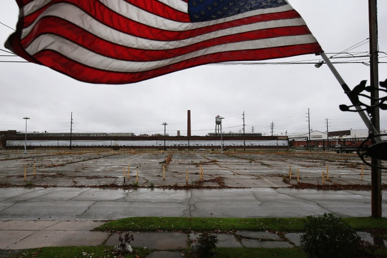 An overgrown parking lot lies empty in front of the closed Packard Electric complex on Oct. 29, 2012 in Warren, Ohio. (Photo by John Moore/Getty)