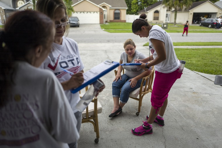 Soraya Marquez, state coordinator for Mi Familia Vota, and her crew hit a Puerto Rican neighborhood, registering Latinos to vote in the 2016 presidential election on July 24, 2015 in Kissimmee, Fl. (Photo by Charles Ommanney/The Washington Post/Getty)