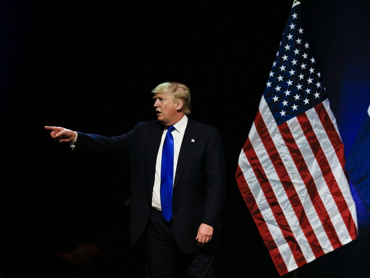 Republican presidential candidate Donald Trump points towards a demonstrator in the audience as he spoke at an election rally in Kansas City, Mo., March 12, 2016. (Photo by Nati Harnik/AP)