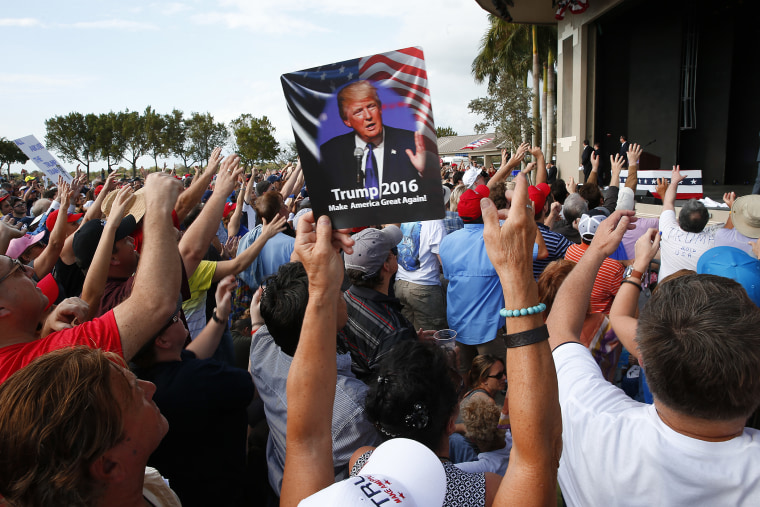 Audience members cheer at a Republican presidential candidate Donald Trump campaign rally in Boca Raton, Fl., March 13, 2016. (Photo by Paul Sancya/AP)