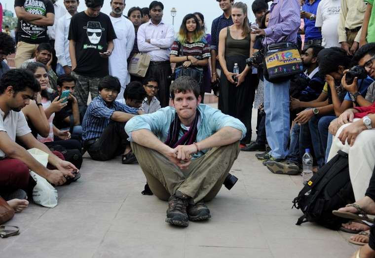 American photographer and blogger Brandon Stanton with his young followers in Central Park at Connaught Place on Sep. 12, 2014 in New Delhi, India. (Photo by Vipin Kumar/Hindustan Times/Getty)