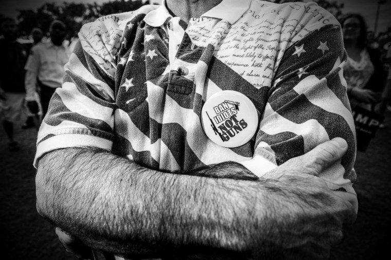 """A supporter of Donald Trump wearing a \""""Ban idiots, not guns\"""" button at a rally in Boca Raton, Fl. (Photo by Mark Peterson/Redux for MSNBC)"""