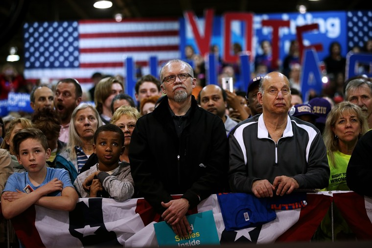 Supporters look on as Hillary Clinton speaks during a Get Out the Vote event at the Nelson-Mulligan Carpenters' Training Center on March 12, 2016 in St Louis, Mo. (Photo by Justin Sullivan/Getty)