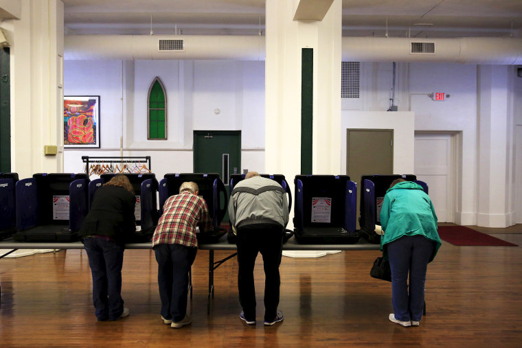 Voters cast their ballots for the Ohio primary at Saint Patrick's Social Hall in Youngstown, Ohio, March 15, 2016. (Photo by Aaron Bernstein/Reuters)