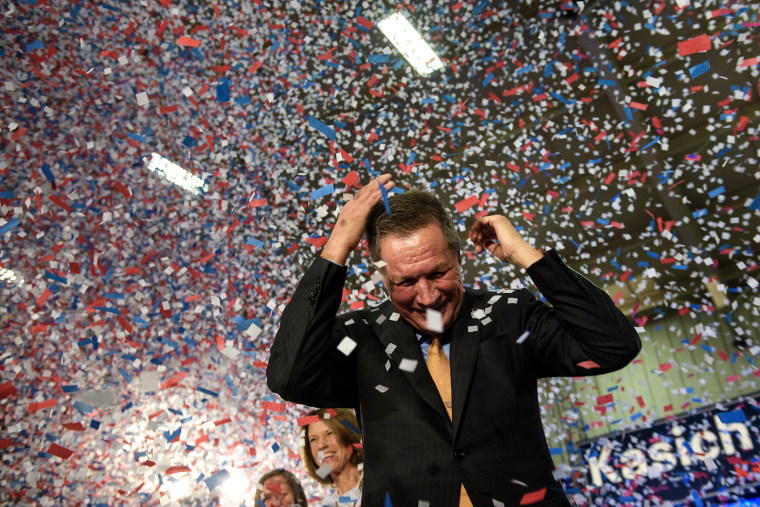 Republican Presidential hopeful Ohio Governor John Kasich celebrates his Ohio primary victory during voting day rally at Baldwin Wallace University March 15, 2016 in Berea, Ohio. (Photo by Brendan Smialowski/AFP/Getty)