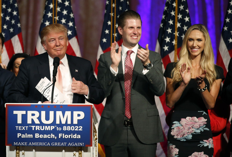 Republican presidential candidate Donald Trump (L), with his son Eric Trump and daughter-in-law, Lara Trump, addresses the media following victory in the Florida state primary on March 15, 2016 in West Palm Beach, Fl. (Photo by Rhona Wise/AFP/Getty)