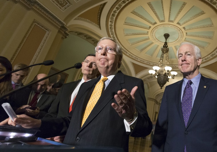 Senate Majority Leader Mitch McConnell, flanked by Sen. John Barrasso, R-Wyo., and Majority Whip John Cornyn, R-Texas, talks to reporters following a closed-door meeting at the Capitol in Washington, March 15, 2016. (Photo by J. Scott Applewhite/AP)