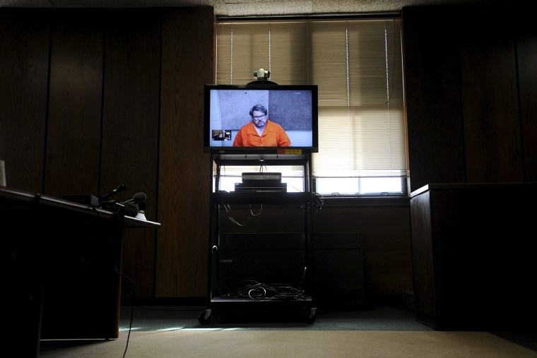 Jason Dalton is seen on closed circuit television during his arraignment in Kalamazoo County, Mich., Feb. 22, 2016. (Photo by Mark Kauzlarich/Reuters)