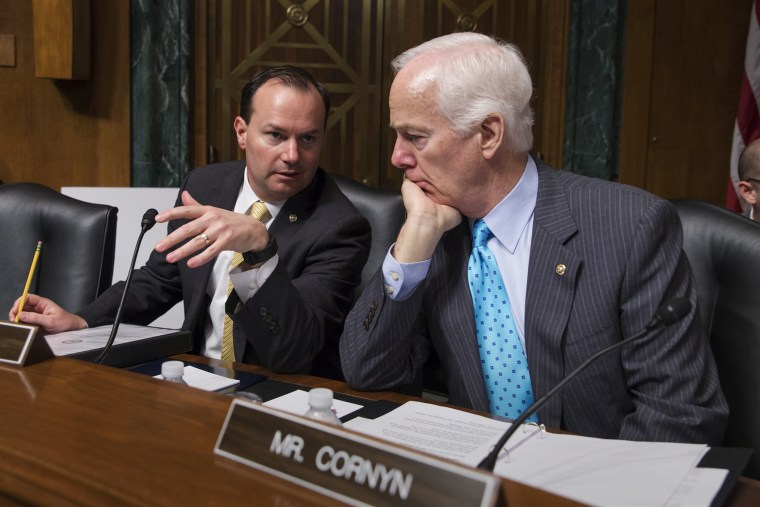 Sen. Mike Lee, R-Utah, and Sen. John Cornyn, R-Texas, confer at the start of a Senate Judiciary Committee hearing, on Capitol Hill in Washington, March 16, 2016. (Photo by J. Scott Applewhite/AP)