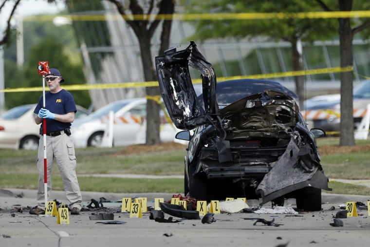 In this May 4, 2015 file photo, FBI crime scene investigators document evidence outside the Curtis Culwell Center in Garland, Texas. (Photo by Brandon Wade/AP)