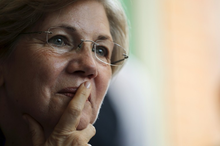 U.S. Senator Elizabeth Warren listens to workers tell their stories about erratic workplace schedules at the Equal Exchange Cafe in Boston, Mass., July 20, 2015. (Photo by Brian Snyder/Reuters)