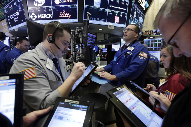 Traders on the floor of the N.Y. Stock Exchange, March 18, 2016. U.S. stocks opened higher again, setting the market up to extend its winning streak to a fifth week and erasing most of the year's early losses. (Photo by Richard Drew/AP)