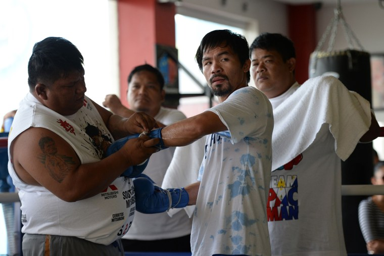 )Philippine boxing legend Manny Pacquiao prepares for a training session with his staff at a gym in General Santos City in the southern Philippine island of Mindanao., Feb. 15, 2016. (Photo by Ted Aljibe/AFP/Getty)