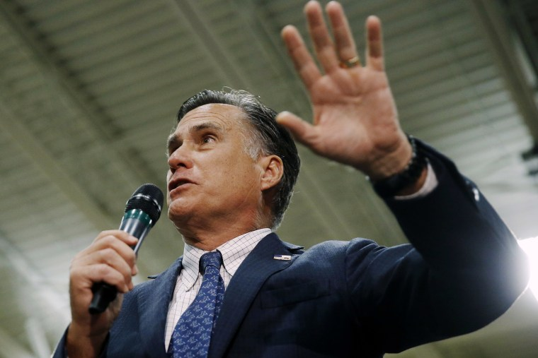 Former Republican presidential candidate Mitt Romney speaks at a campaign stop for another Republican presidential candidate, Ohio Gov. John Kasich, March 14, 2016, at Westerville Central High School in Westerville, Ohio. (Photo by Matt Rourke/AP)