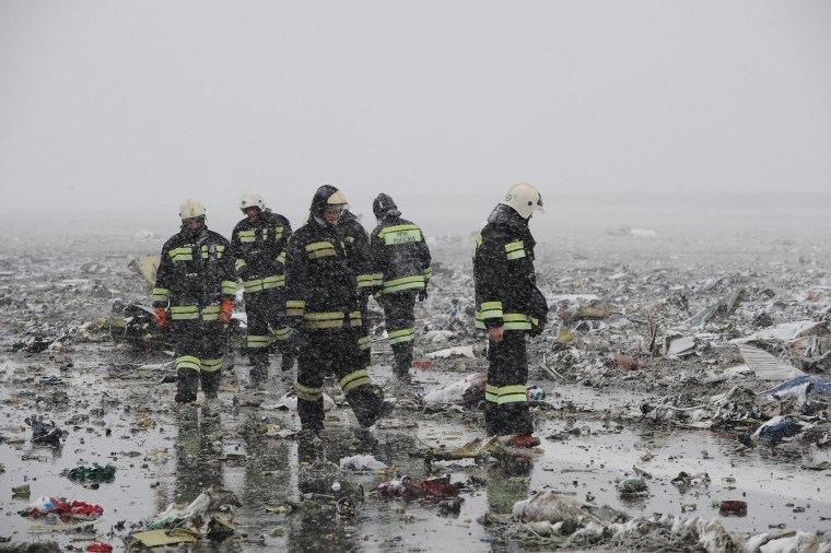 Russian Emergency Ministry employees are seen among the wreckage of a crashed plane at the Rostov-on-Don airport, about 950 kilometers (600 miles) south of Moscow, Russia, March 19, 2016. (Photo by STR/AP)