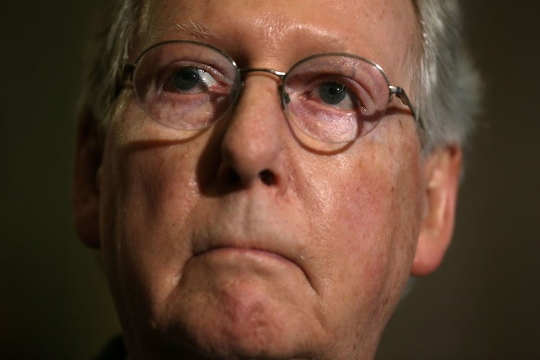 U.S. Senate Majority Leader Sen. Mitch McConnell listens during a news briefing after the weekly Republican policy luncheon, March 8, 2016 on Capitol Hill in Washington, DC. (Photo by Alex Wong/Getty)