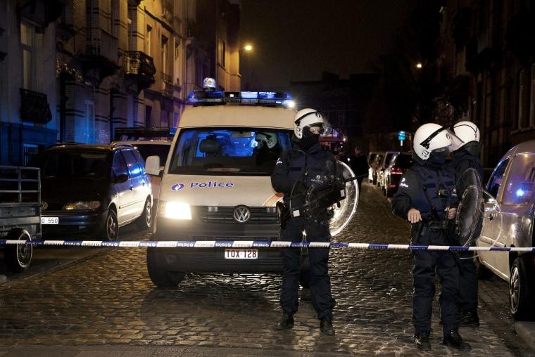 Policemen stand guard the street at Rue de la Carpe in Molenbeek-Saint-Jean in Brussels, on March 19, 2016. (Photo by Nicolas Maeterlinck/AFP/Getty)