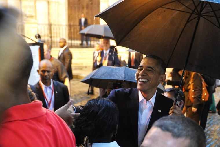 President Barack Obama talks to tourists and Cubans at his arrival to the Havana Cathedral, on March 20, 2016. (Photo by Yamil Lage/AFP/Getty)