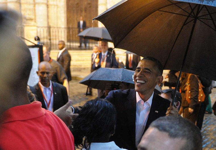 President Obama talks to tourists and Cubans at his arrival to the Havana Cathedral, on March 20, 2016. (Photo by Yamil Lage/AFP/Getty)