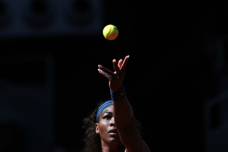 Serena Williams from U.S. serves during a match at the Madrid Open tennis tournament, in Madrid, May 11, 2013. (Photo by Andres Kudacki/AP)