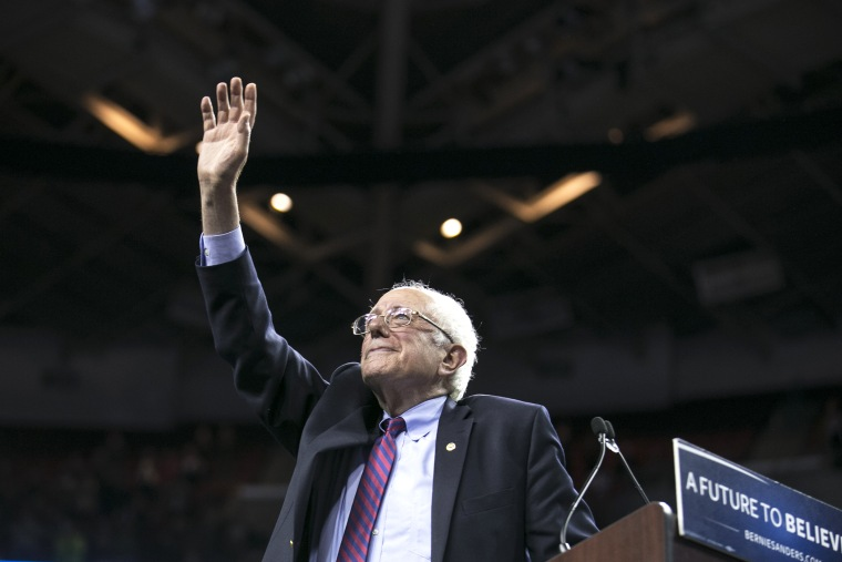 Democratic presidential candidate Sen. Bernie Sanders, I-Vt., waves to the crowd after speaking on March 20, 2016, at a campaign rally in Seattle, Wash. (Photo by Stephen Brashear/AP)