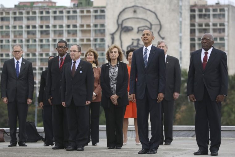 "Back dropped by a monument depicting Cuba's revolutionary hero Ernesto ""Che"" Guevara, U.S. President Barack Obama and other members of the U.S. delegation stand during a ceremony at the Jose Marti Monument in Havana, Cuba, Monday March 21, 2016."