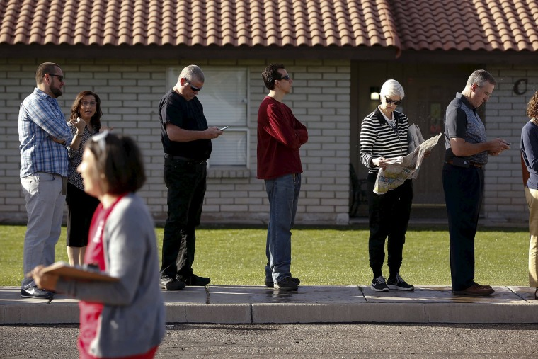People wait to vote in the presidential primary election outside a polling site in Glendale, Ariz., March 22, 2016. (Photo by Nancy Wiechec/Reuters)