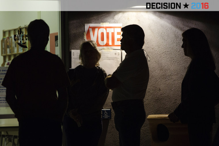 Early morning voters stand in line before sunrise to vote in Arizona's presidential primary election at a polling station in Cave Creek, Ariz., March 22, 2016. (Photo by Nancy Wiechec/Reuters)