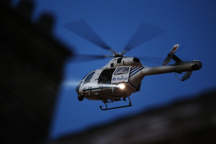 A police helicopter hovers over Brussels' rooftops following bomb attacks in Brussels, Belgium, March 22, 2016. (Photo by Christian Hartmann/Reuters)