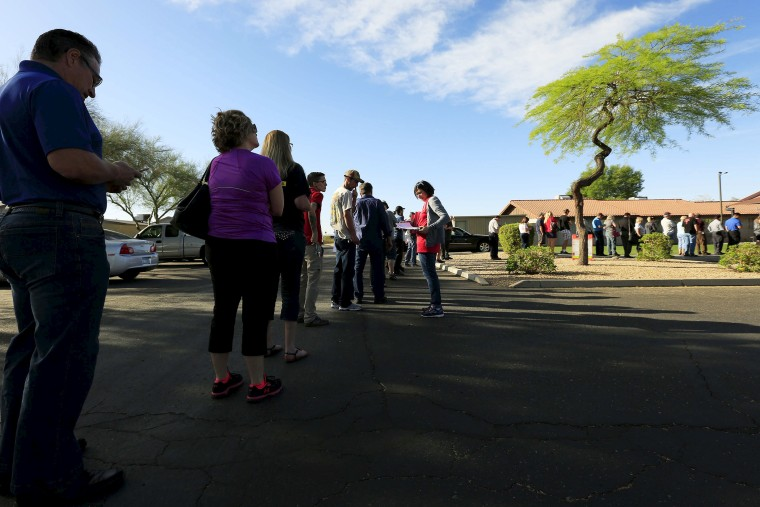 People wait to vote in the U.S. presidential primary election outside a polling site in Glendale, Ariz. on March 22, 2016. (Photo by Nancy Wiechec/Reuters)