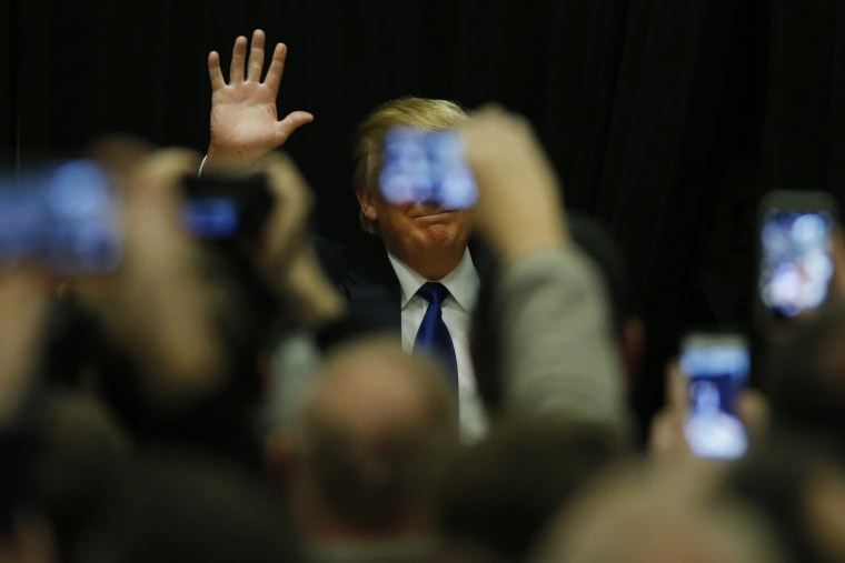 Republican presidential candidate Donald Trump speaks at a campaign event at Clinton Middle School in Clinton, Iowa, Jan., 30, 2015. (Photo by Carlos Barria/Reuters)