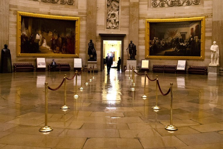 A man walks through a nearly empty Capitol Rotunda on Capitol Hill in Washington. (Photo by Evan Vucci/AP)