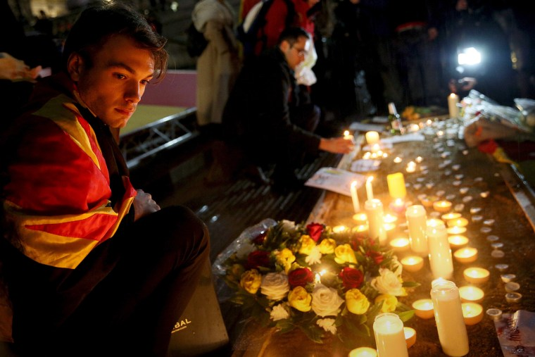 A man looks at candles during a vigil for the victims of the Brussels bomb attacks, at Trafalgar Square in London, Britain, March 24, 2016. (Photo by Neil Hall/Reuters)