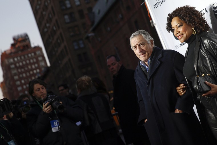 Robert De Niro stands with his wife Grace Hightower upon arriving for the 2014 Tribeca Film Festival opening night screening of 'Time Is Illmatic' in New York, April 16, 2014. (Photo by Shannon Stapleton/Reuters)