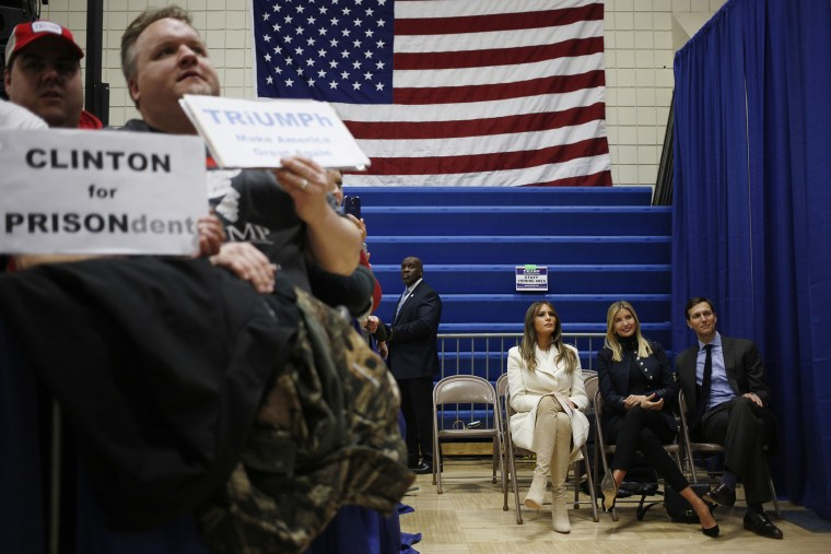 As Donald Trump speaks, wife Melania Trump, seated left, daughter Ivanka Trump, daughter of Donald Trump, seated center, and son-in-law Jared Kushner listen offstage during a campaign rally in Council Bluffs, Iowa, U.S., on Jan. 31, 2016.