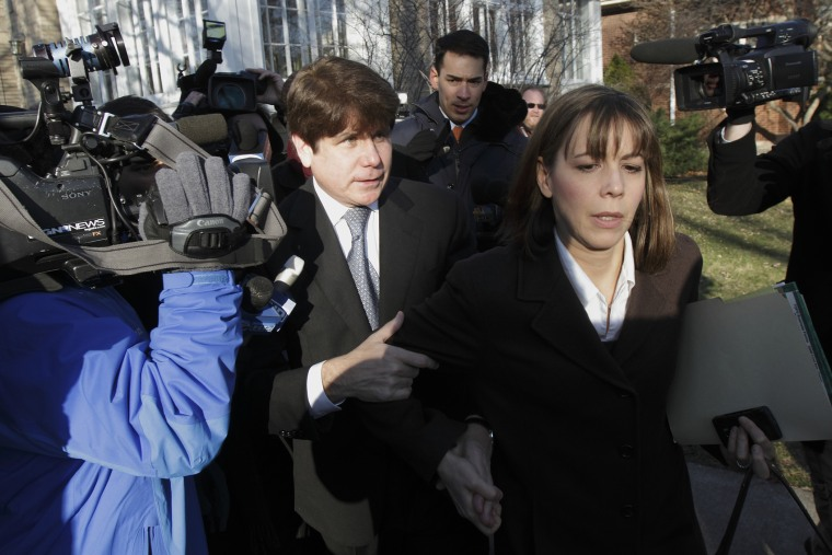 Disgraced former Illinois Gov. Rod Blagojevich and his wife Patti leave their Chicago home for the second day of his sentencing hearing, Dec. 7, 2011. (Photo by John Gress/Reuters)