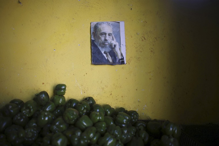 A photograph of Cuba's former President Fidel Castro decorates a wall inside a state-run market in Havana, March 8, 2016. (Photo by Alexandre Meneghini/Reuters)