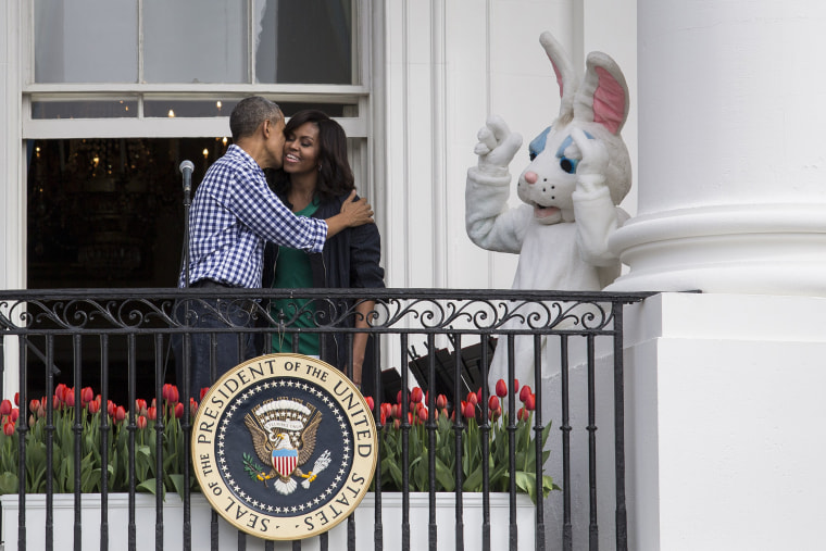 President Barack Obama kisses first lady Michelle Obama after they spoke to the crowd during the annual White House Easter Egg Roll on the South Lawn of the White House March 28, 2016 in Washington, D.C. (Photo by Drew Angerer/Getty)