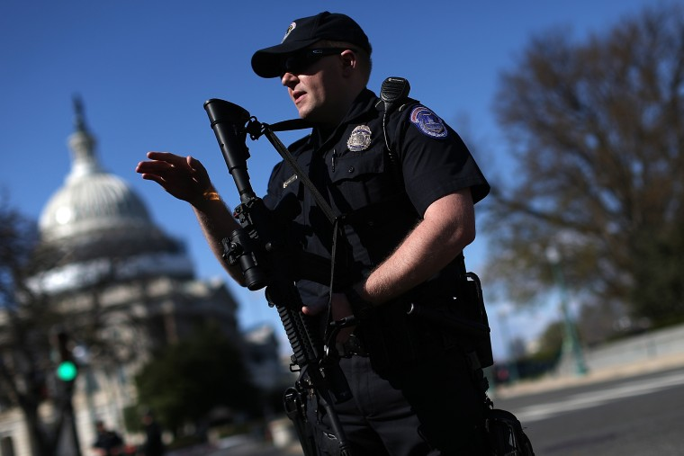 Heavily armed Capitol police stand guard after at least one person was shot in the Capitol Visitor Center March 28, 2016 in Washington, DC. (Photo by Win McNamee/Getty)