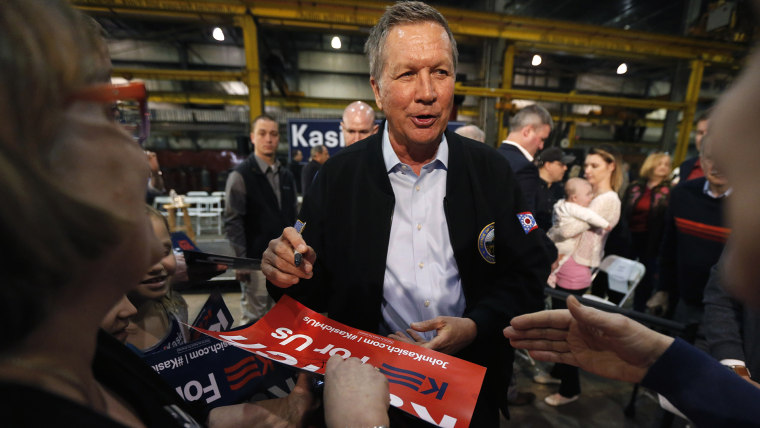 Republican presidential candidate, Ohio Gov. John Kasich works the crowd after a town hall meeting at the River Steel plant, March 28, 2016, in West Salem, Wis. (Photo by Charles Rex Arbogast/AP)