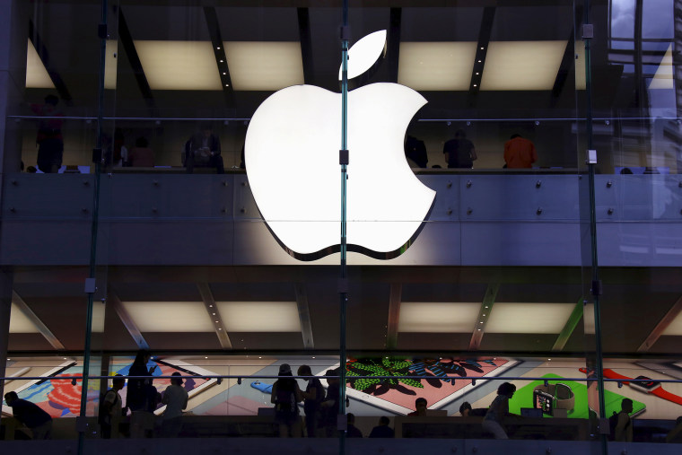 Customers can be seen inside the Apple store in central Sydney, Australia, in this picture taken March 18, 2016. (Photo by David Gray/Reuters)